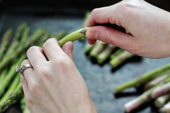 snapping asparagus stems