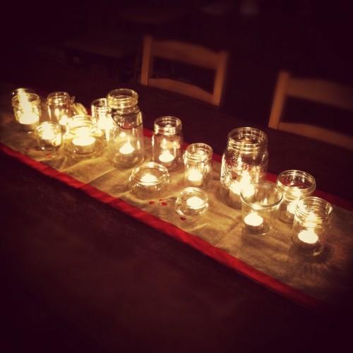 Holiday centerpice of tea lights in jars