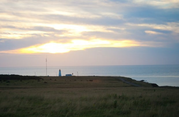 sunset over Cheticamp lighthouse