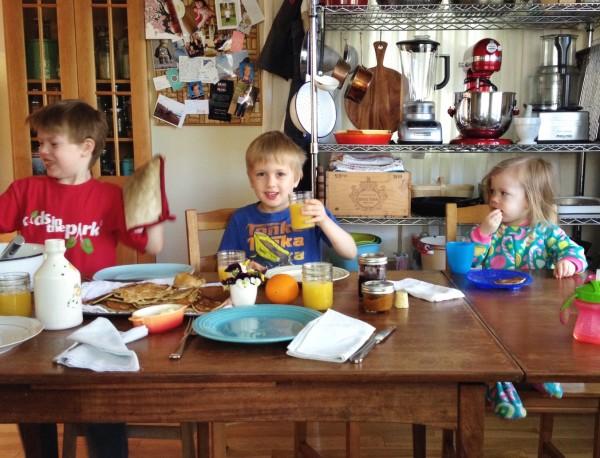 3 kids making breakfast