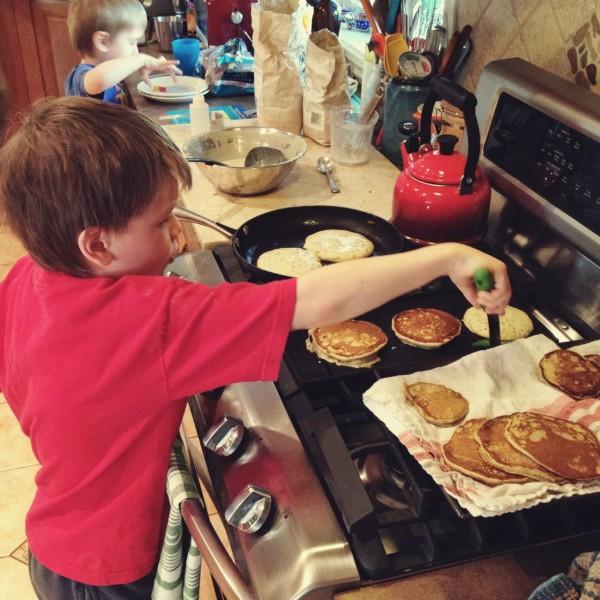 boys frying pancakes